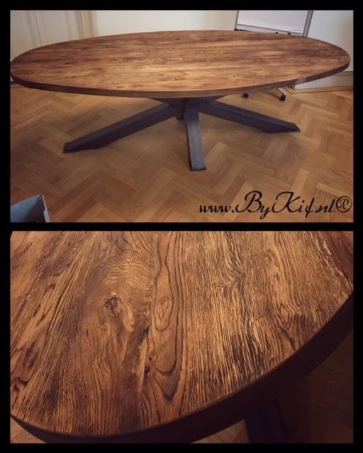 ronde tafel boomstamblad en ijzeren sterpoot